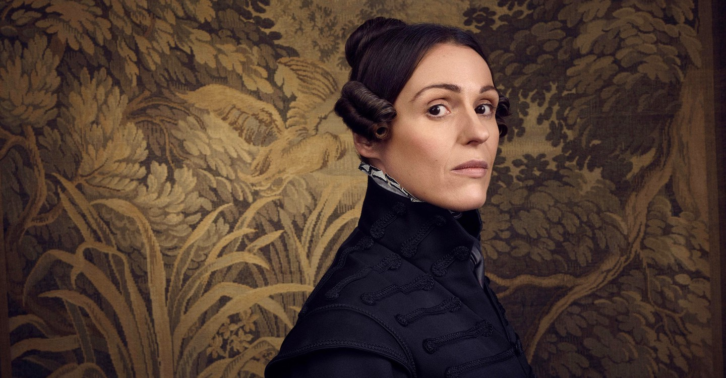 Lead performer in Gentleman Jack wearing dark clothes and standing in front of an ornate background, she has been nominated for a BAFTA for her LGBT+ role